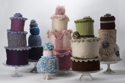 """Cake!"" 2013 medium is knit and crocheted yarn, recycled foam and stuffing, glass and ceramic cake plates. melissa maddonni haims, fiber artist"