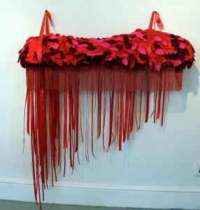 """Carole Loeffler, flourishing fuchsia flood, 2014, 61""""x56""""x14"""", foam, wood, fabric, felt, ribbon, glue"""